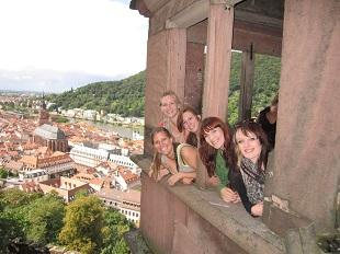 Students peeking out a window